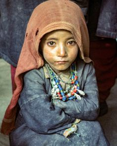 A young girl dressed in her tribes beads rests in a marketplace far from her distant village in northern Pakistan. Photo from my book #VanishingAsia #pakistan