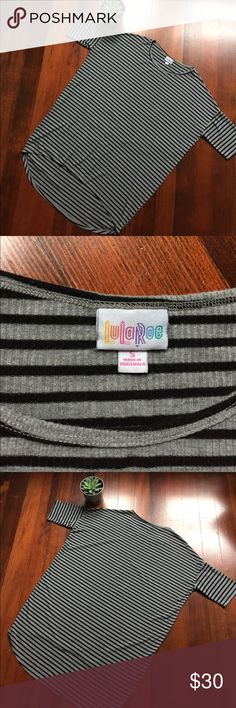LuLaRoe Irma Gray and Black Striped Tunic Top This is a LuLaRoe Irma tunic top. This is an easy piece to transition into different seasons! It's a ribbed gray and black stripe top. One small hole that is not noticeable (look at last photo) and no other flaws! This is loose and does cover your butt so it's perfect with leggings! Size: small. Let me know if you have any questions. LuLaRoe Tops