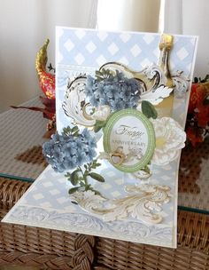 Card by Vickie Blakeslee. Anna Griffin Engraved Endearments Pop Up card kit and miscellaneous heart button used to create this card.