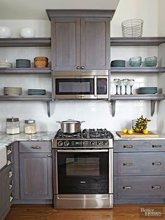 Open shelves eliminate the heavy look of closed cabinetry and lighten up small spaces Closed base cabinets provide storage for utilitarian notsodisplayworthy pieces while. Kitchen Decor, Kitchen Inspirations, New Kitchen, Kitchen Shelves, Small Kitchen, Home Kitchens, Kitchen Remodel, Open Kitchen Shelves, Kitchen Renovation