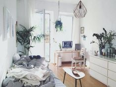 The shared room looks cozy and airy-free at the same time! The many plants bring freshness into the room. The chic ceiling lamp and the cool table make for a modern flair! # ideas # plants - Home Decor Deco Studio, One Room Apartment, Modern Bedroom Design, Modern Design, Awesome Bedrooms, Room Set, Interior Design Living Room, Room Inspiration, Bedroom Decor