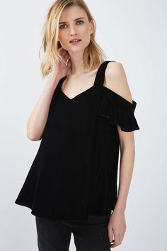 Style your bump the luxe way in this velvet cold shoulder top for Maternity. Wear with ripped jeans and heeled sandals for a go-to going out look. #Topshop