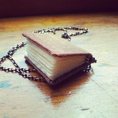 Wearable Library - Tiny Book Necklace in Gryffindor Pride