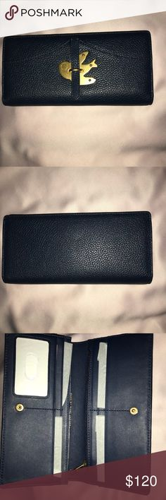 """NWT Marc Jacobs wallet NWT Marc Jacobs Petal to the Metal navy blue bifold wallet.  7 1/2 """" L x 1"""" H x 3"""" W Exterior features gold tone hardware with bird detail.  Interior has ID window, one pocket with zip closure, ten card pockets (that is including the ID window), dual bill pockets. Marc By Marc Jacobs Bags Wallets"""
