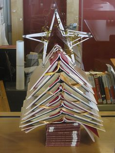 Christmas tree o' books, via Flickr.