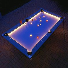 When you play pool in the dark, you need the table to be lit up in style, billiard lights just won't do in a contemporary setting. This regulation-size pool table is made from aluminum and solves just that. Each of its four edges are LED illuminated in the glow of beautiful white light.