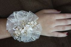 Wrist corsage hand  corsage with vintage by TheCrystalFlower, $45.00  Nice idea for bridesmaids!