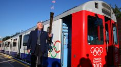 London Underground driver John Light prepares to carry the Olympic flame into the cab of a district line train on Day 67 of the torch relay London Underground Train, Olympic Flame, Kingston Upon Thames, Paris Metro, London Transport, Nyc Subway, Kew Gardens, Design, Olympic Travel