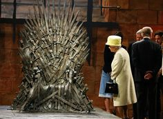 "Britain's Queen Elizabeth looks at the Iron Throne as she meets members of the cast on the set of the television series ""Game of Thrones"" in the Titanic Quarter of Belfast, Northern Ireland, on June 24, 2014. (Reuters/Phil Noble) 
