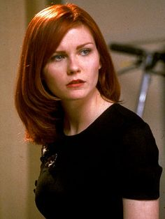 Kirsten Dunst. Can't decide if I like this red or the lighter red more.