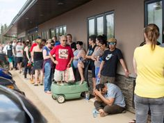 People who have been evacuated from Fort McMurray line up outside a grocery store in Anzac, about 50 kilometres south of the city. May 4 2016