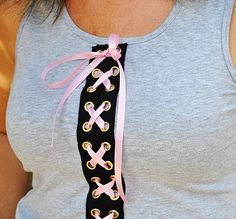 Cute-ify your T ~ Lace it up.  Easy to do with pre-made grommet trim from the fabric store  :)