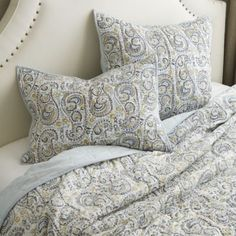 Paisley Hand Blocked Quilt Bedding. Found on Ballard Designs.  Get rid of blue quilt, use this paisley quilt and the white twin duvets.  Light blue fitted sheet, yellow patterned (Greek key) pillow.