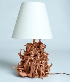 LOVE THIS: Remember those little action figures you played with as a kid? Hannah of Story by ModCloth took a cue from childhood when crafting this superhero-packed lamp using hot glue and copper spray paint.