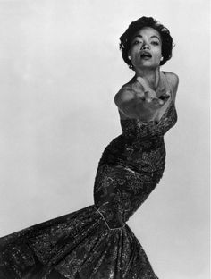 Eartha Kitt photographed by Philippe Halsman, 1954.  Wow! I love the look the whole style of this an art form you can wear. ~SB