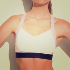 Calvin Klein Flex Motion Bra Convertible sports bra by Calvin Klein. It has a contoured seaming and molded cups separate and support the busy during high activities. Wide convertible straps adjust for over the shoulder or cross back wear. 4 way stretch microfiber fabric for flexible motion. Mesh detailing and lining for cooling comfort and breath ability.  Calvin Klein Intimates & Sleepwear Bras
