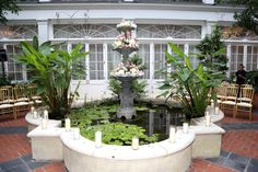 Fountain Courtyard wedding at Royal Sonesta Hotel. Altar.
