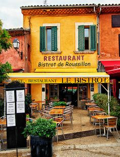 The restaurant Le Bistrot, in Roussillon, Provence, France. Wander this quaint town or hike the red clay canyon nearby then relax for some wine. Provence France, Paris France, Roussillon France, Moustiers Sainte Marie, Belle France, Valensole, Sidewalk Cafe, French Cafe, French Countryside