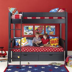 Superhero Themed Black Wooden Aspace Bunk Bed with Star Pattern Red Bedding also Two Storage Drawers and Tilt Style Stairs for Kids Room Furniture Ideas