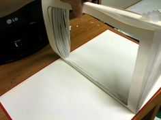 How to make a book iPad case.  Perfect for those who appreciate the convenience of an e-reader but like to hold a real book in their hands.