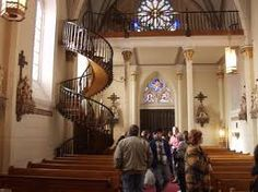 Loretto Chapel Staircase, Santa Fe, NM.  A masterpiece and a mystery of woodworking, this sprial structure is entirely self supporting, without a central column to provide stability and with wooden pegs instead of nails.