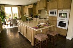 Spacious white U-shaped kitchen with dark countertops throughout.
