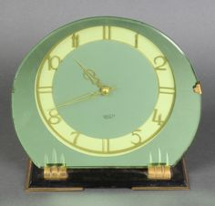 "Lot 765, An Art Deco electric mantel timepiece contained in a mirrored glass frame 25""h, est £30-50"