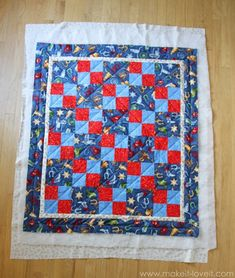 Binding with the back of the quilt.