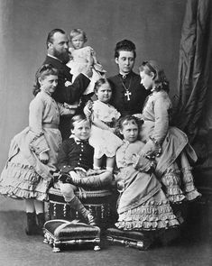 Alice and Louis with their children: Marie in the Grand Dukes arms and (left to right) Ella, Ernie, Alix, Irene, and Victoria