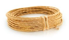 """Wellendorff Brilliance of the Sun Bracelet - Silky strands of 18-karat yellow gold, created in a unique handwoven process, with Wellendorff's signature """"W"""" drop. // *Cellini Jewelers is an authorized dealer of Wellendorff jewelry. Please visit our 509 Madison Avenue boutique to view our extensive Wellendorff collection."""