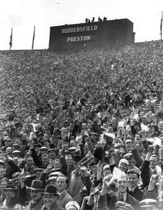 Old Photos of Football Fans from 1900s–1940s. Crowds of supporters fill the stands at Wembley Stadium for the FA Cup Final between Preston North End and Huddersfield Town. Preston won 1-0 after extra time. (Photo by Keystone/Getty Images). 30th April 1938.