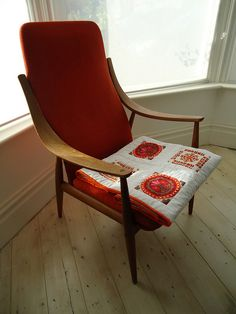 my folk flowers quilt on our Peter Hvidt chair