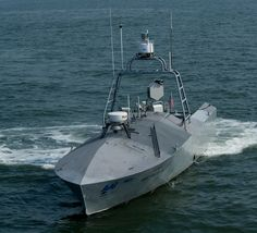 The Navy recently test-fired missiles from a robot boat. Here a common unmanned surface vehicle patrols for intruders during the Trident Warrior 2011 experiment.