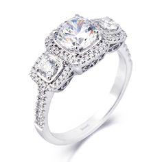 Style MR2080, 18K white gold ring with .29ctw round white diamonds and .35ctw side diamonds, $3,520, Simon G