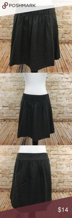 """J. Crew Factory charcoal grey wool skirt. Size 4 J. Crew Factory charcoal grey wool skirt. Size 4. Fully lined and has pockets. Side zip closure. Excellent condition!  Approx Measurements: waist - 31"""", length - 16.5"""". Material: 38% wool, 31% polyester, 28% viscose, 3% spandex; lining - 100% acetate. Care: dry clean. J. Crew Factory Skirts Mini"""