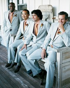 The groomsmen were decked out in slate suits, melon-and-white checkered shirts, and coordinating ties.
