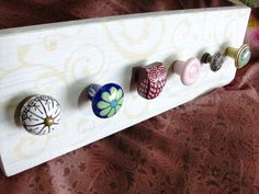Jewelry necklace holder using dresser drawer knobs and wood.  Listed on Etsy for $35.00.