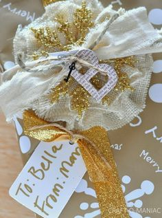 The Creative Studio / DIY Christmas Gift Wrapped Package - canvas fringe and burlap flowers for holiday decorating