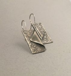 Silver earrings, hand forged fold over, hammered celestial texture by MetalingSusie on Etsy