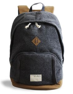 this sweatshirt-y laptop backpack comes with a hidden elastic waterproof rain hood. so smart!