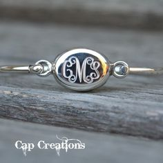Monogram bangle bracelet in sterling silver...too bad I didn't see this earlier for a graduation gift idea ;-)