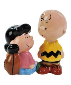 Add a dash of salt or pinch of pepper with this ''Peanuts'' shaker set. Constructed from durable, food-safe ceramic and modeled after a pair of familiar cartoon icons, they're the perfect supper seasoners for a magical meal.