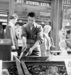 A Chapel Street Market eel stall, outside Manze's: 1955. By Henry Grant.