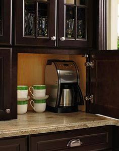 Cabinets with outlets to hide toasters and coffeemakers. rather than garage with drawer.