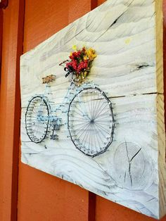 This string art sign consists of planked wood, painted off-white and sanded to look aged. The bicycle basket holds a bouquet of pink and yellow flowers. The basket is decorated with a black and white polka dot ribbon.  **Please add a note in your order if you would like the baby blue bicycle or the black silhouette bicycle. **If you would like to add the words as pictured in the last photo, please send me a convo andI will make a custom order for you. Writing is an additional $7. Dimensions…