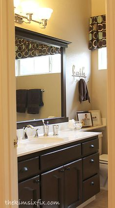 Bathroom Mirror Makeover diy bathroom mirror frame for under $10 | blue wood stain and diy