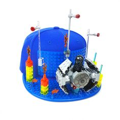 Brick Brick hats lets you create custom designs with interlocking toy bricks, compatible with most toy bricks like Lego®, Mega Bloks® and more. Lego Hat, Paper Models, Gears, Brick, Custom Design, Sculpture, Christmas Ornaments, Toys, Holiday Decor