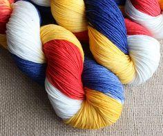 (http://shop.gnomeacres.com/wonder-woman-hand-dyed-yarn-fingering-sock/)  Wonder Woman colors!