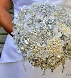 This amazing bouquet is a stunning alternative to traditional flowers. We think it's perfect for the unique, bling-loving bride! #sparkleandshine #bling #bouquet #weddings