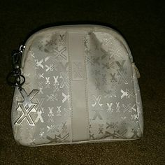 Nexxus make up bag w keychain Off white with leather stripes down middle of both sides with XX on it, also Keychain with lobster claw, has little markings inside and outside as pictured,  a few others unnoticeable nexxus  Other